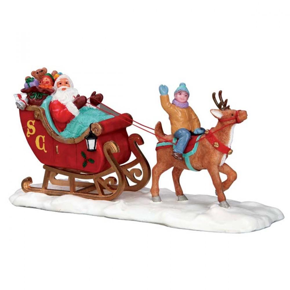 Figura Per Villaggi Lemax 'santa's Sleigh'. Babbo Natale Che Porta I Regali Sulla Sua Slitta Mentre Sulla Renna Un Bambino Si Diverte E Saluta.