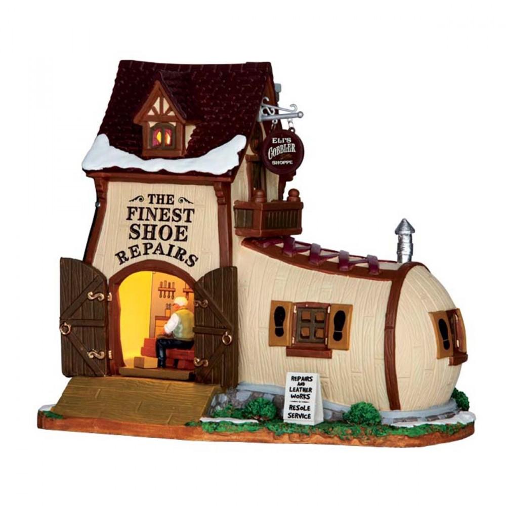 Il Negozio Del Ciabattino 'eli's Cobbler Shoppe', è Un Negozio Di Lemax Per Rendere Unico Il Tuo Villaggio Di Natale. Questo Edificio A Forma Di Scarpa Si Illumina.